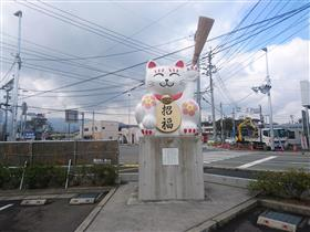 Photograph of western parking lot dismissal cat monument